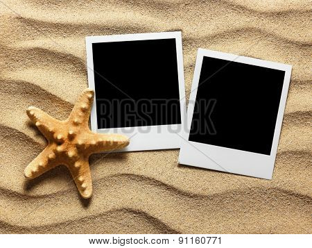 Old style empty photo card on sea sand sunny background. Close up