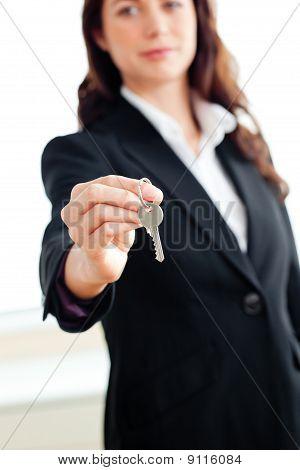Portrait Of An Assertive Businesswoman Holding A Key