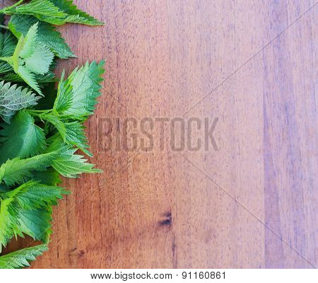 Nettle On A Wooden Background