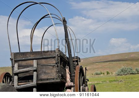Covered Wagon Facing The Road Ahead