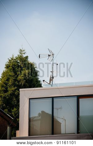 Digital And Analog Antenna Next To Satellite Dish On The Same Mast