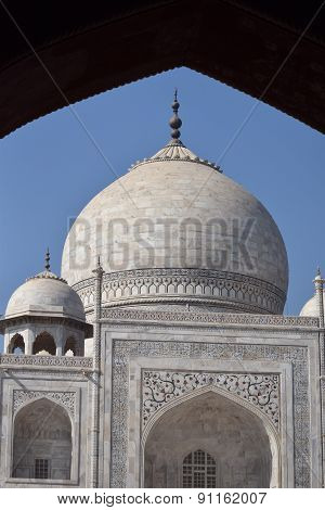Taj Majal through arch with blue sky