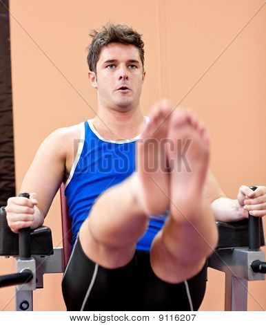 Muscular Young Man Exercising