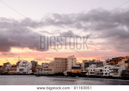 Sea and Building at Sunset