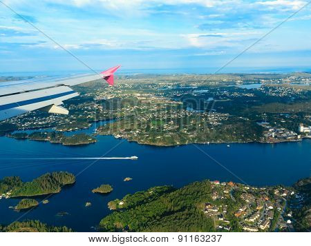 View From Window Of Airplane Flying Over Norway Scandinavia.