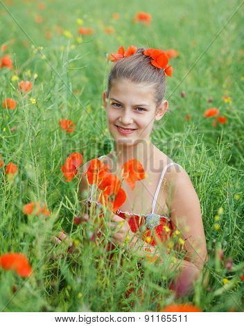 Cute girl in poppy field
