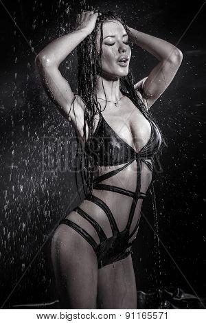 Sexy Brunette Woman In Rain.