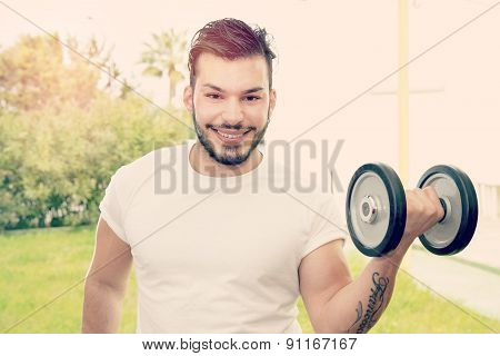 Guy Holding Barbells Warm Filter Applied