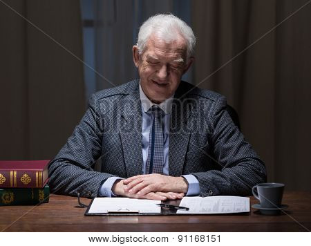 Businessman And Paperwork