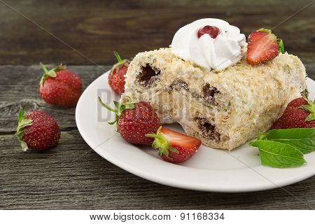 Slice Of Cream Puff Cake With Strawberry On Wooden Table. Selective Focus