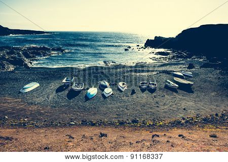 boats on a sandy stony tide