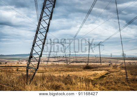 scenic landscape of fields with power transmission lines