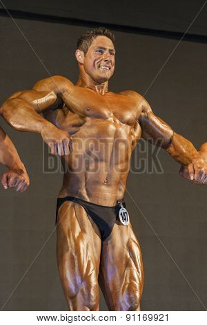Professional Male Caucasian Bodybuilder Performing On Stage.