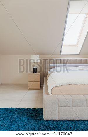 Bedroom With Inclined Wall