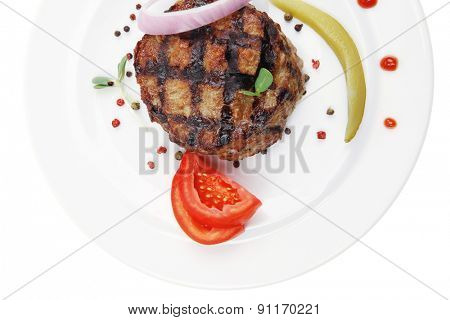 extra thick hot beef meat hamburger dinner on white plate with tomatoes salad and ketchup isolated on white background