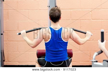 Charismatic Male Athlete Practicing Body-building