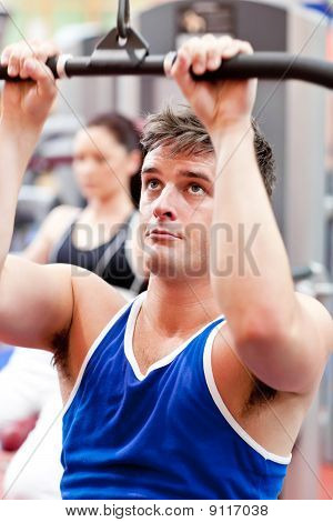 Male Athlete Practicing Body-building