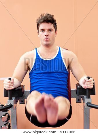 Serious Young Man Exercising