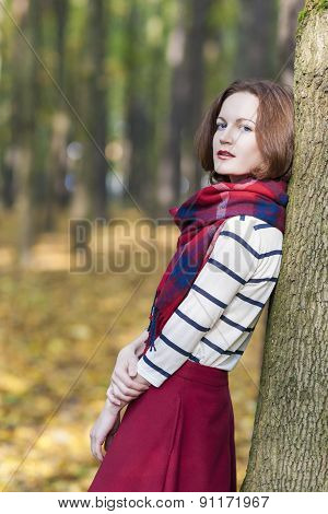 Style Concept: Young Caucasian Brunette Female In Made To Measure Clothing. Outdoors Photoshot