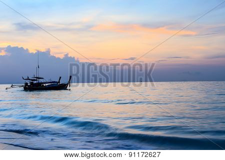 Sunrise And Long Tail Boat On The Ocean Waves