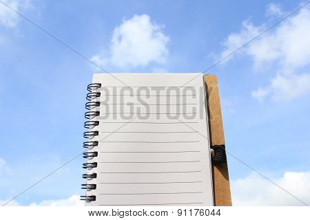 One Page Notebook On The Background Of Sky