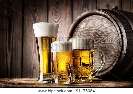 Two glasses and mug of light beer