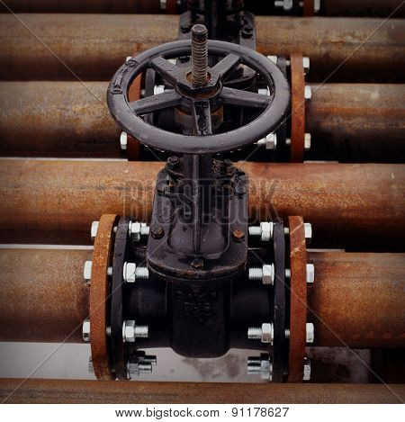 Oil and gas pipeline valves on a piping