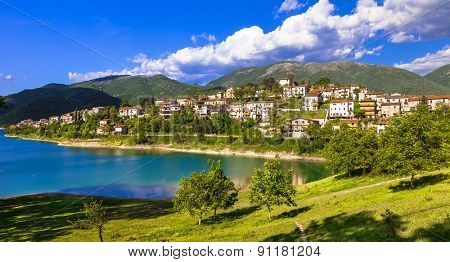 Scenic lake Turano and village Colle di Tora, Itay