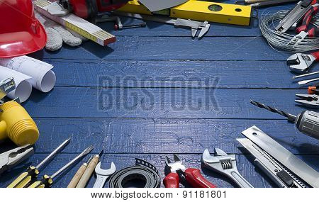 Carpenter Tools on Blue Wood. Blueprints are not subject to copyright. Words on them are regular like kitchen, bedroom, bathroom etc.
