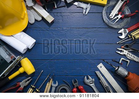 Carpenter Tools on Blue Wood.Blueprints are not subject to copyright. Words on them are regular like kitchen, bedroom, bathroom etc.