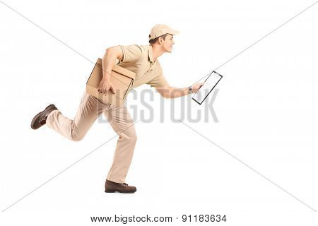 Full length portrait of a delivery guy running with a cardboard box and a clipboard in his hands isolated on white background