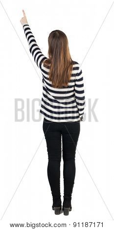 Back view of  pointing woman. beautiful girl. Rear view people collection.  backside view of person.  Isolated over white background. Slim French points a finger
