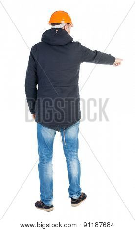 Back view pointing young men in parka and helmet. Young guy  gesture. Rear view people collection.  backside view of person.  Isolated over white background. Young engineer specifies right hand down