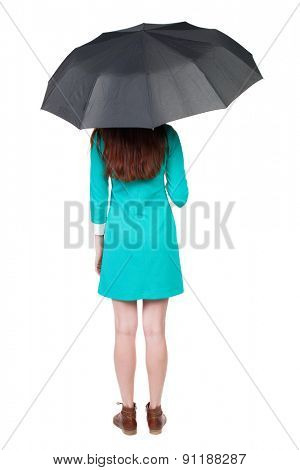 young woman under an umbrella. Rear view people collection.  backside view of person.  Isolated over white background. The girl in a blue dress with brown boots hiding under an umbrella