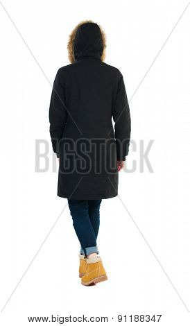 Back view of going  woman in parka. walking young girl. Rear view people collection.  backside view of person.  Isolated over white background. Wearing a hood on his head girl goes away.