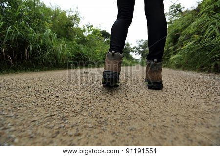 woman hiker hiking on forest trail
