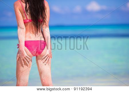 Beautiful woman in red bikini on sea background