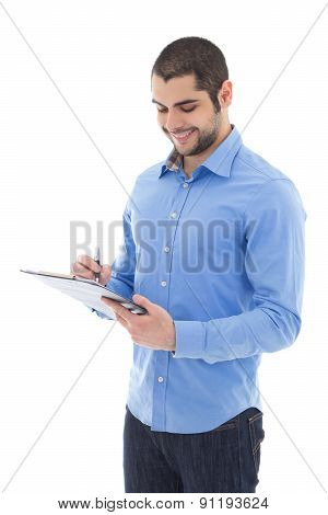 Handsome Arabic Man Writing Something On Clipboard Isolated On White