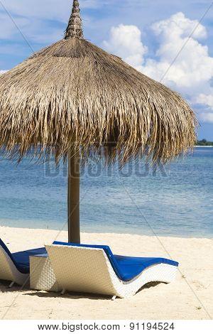 Ocean Coastline With Sun Umbrella.