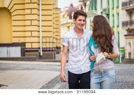 Girl and guy on the streets of European cities