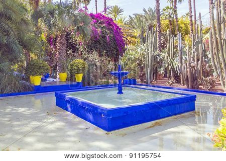 MARRAKESH, MOROCCO, APRIL 4, 2015: Majorelle Gardens - fountain painted in Majorelle Blue