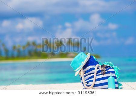 Beach accessories on white tropical beach