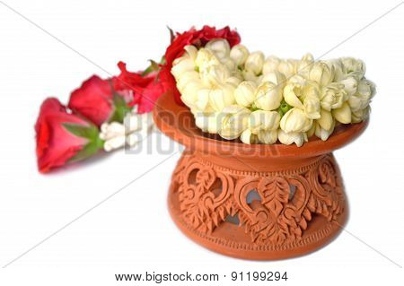 Thai style garland and clay tray