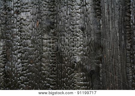 Charred Wooden House Wall After Fire