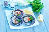stock photo of scallops  - scallop with caviar and lemon juice on a table - JPG