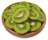 pic of fruit bowl  - Sliced kiwi fruit in a wooden bowl on a white background - JPG