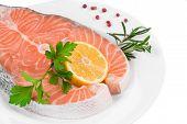foto of salmon steak  - Raw salmon steak with lemon - JPG