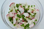 pic of radish  - Salad with radish onion and cabbage on the table - JPG