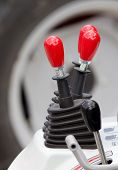 stock photo of levers  - Close up of levers set in agricultural vehicle - JPG