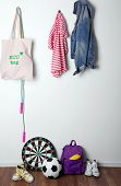 picture of baseboard  - Children things hanging on wall and stacked in room - JPG